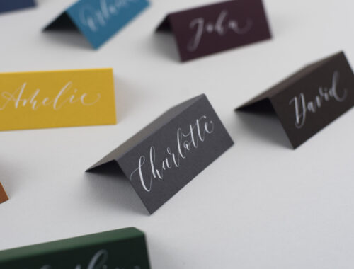 grey placecard with white calligraphy